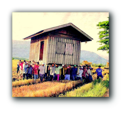 A house being carried by people